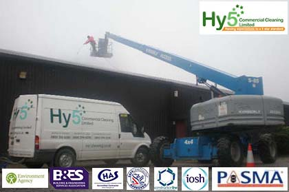 Hy5 cleaning the outside off a large warehouse using a cherry picker
