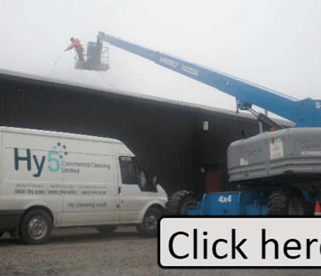 high level cleaning of a warehouse using a cherry picker